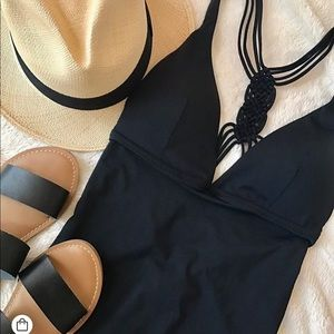 One piece black bathing suit with hat included!